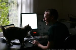 Man working from home with his cat
